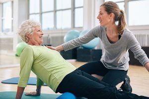 Physiotherapist assisting patient with hip therapy